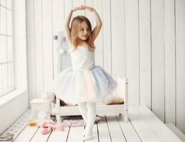Little girl in a ballet tutu. Child in a ballet skirt.